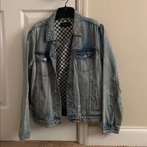 Light denim jean jacket.